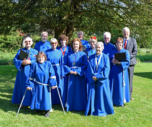 All Saints Warlingham choir singing at the consecration of the new burial gound